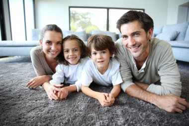 Family relaxing on carpet