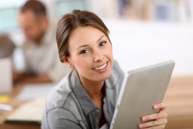 Woman using tablet in business training
