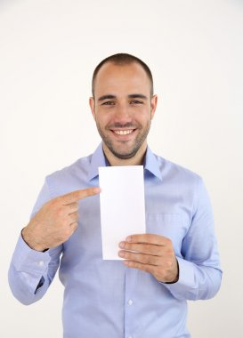 Man holding booklet