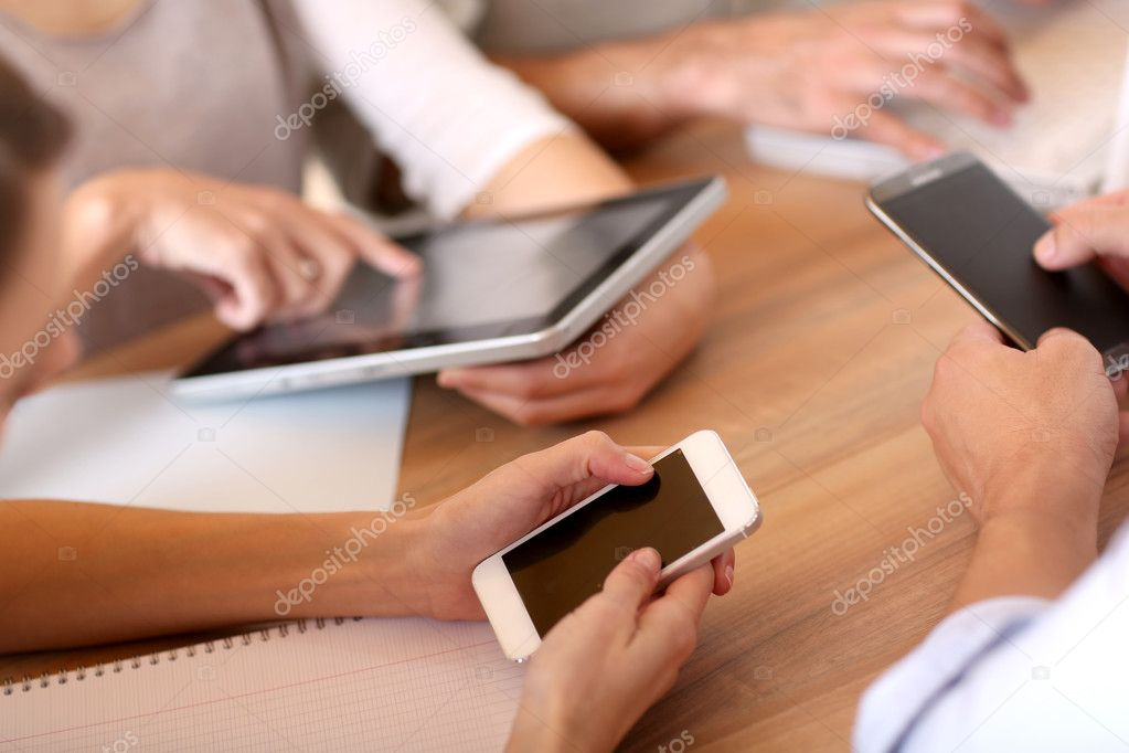 Business people using electronic devices