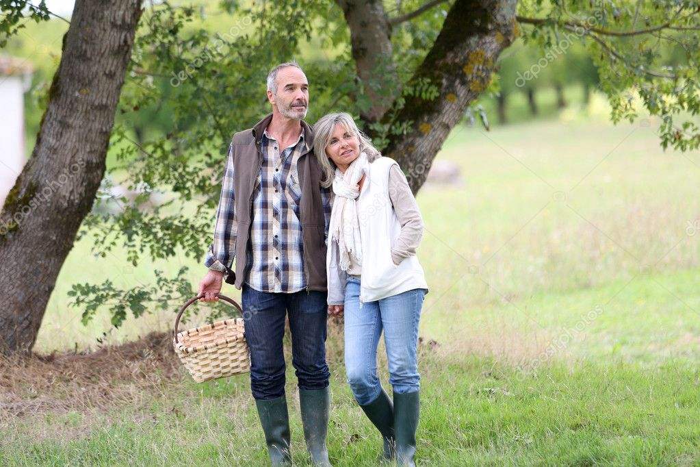 Senior couple walking in countryside