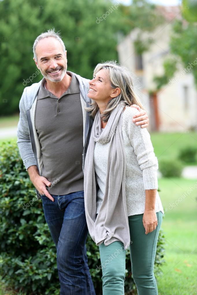 Mature couple walking in garden