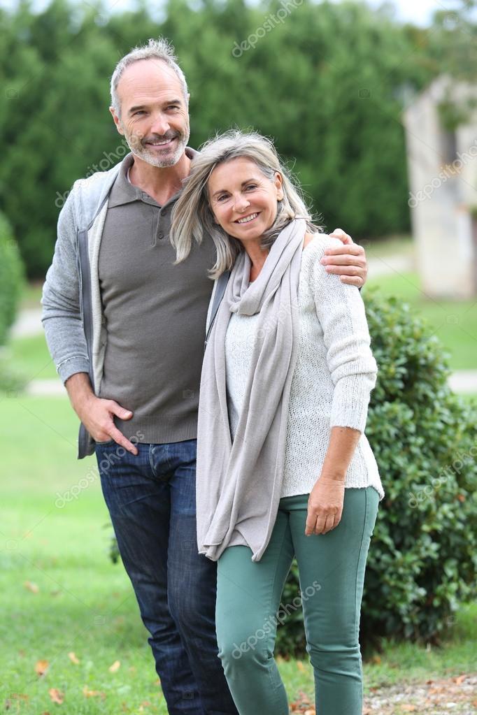 Mature couple walking in garden
