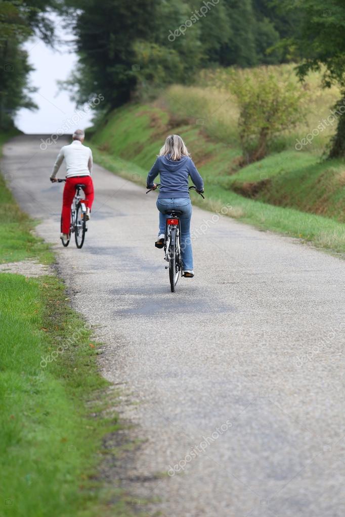 Senior couple riding bicycle