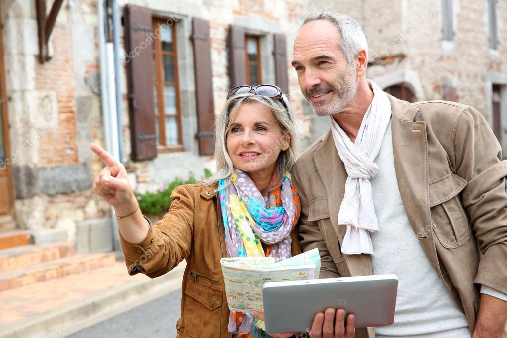 Senior couple visiting city