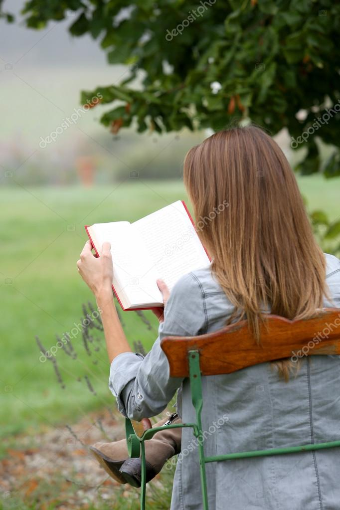 Woman reading book in nature