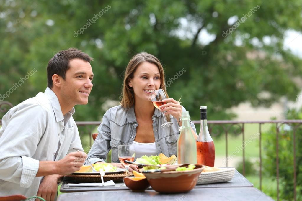 Couple having lunch in hotel garden