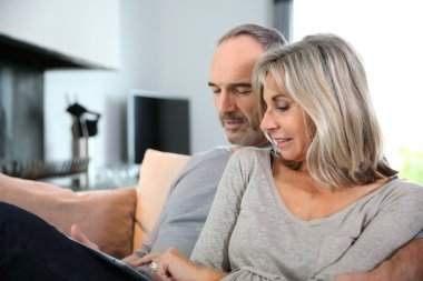 Mature couple with tablet