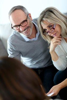 Senior couple and financial adviser