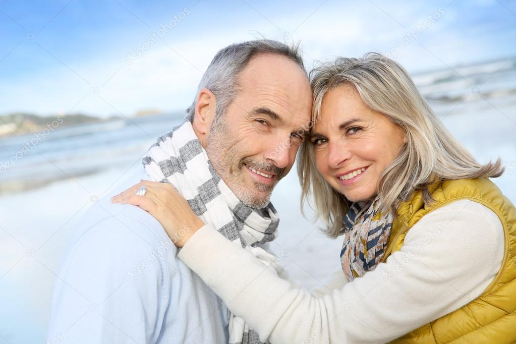 Loving senior couple at beach