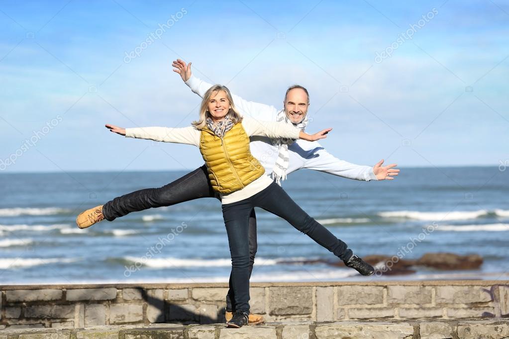 Senior couple on sea background
