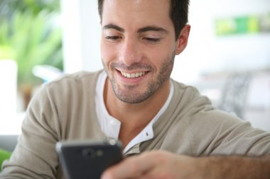 Man connected on smartphone