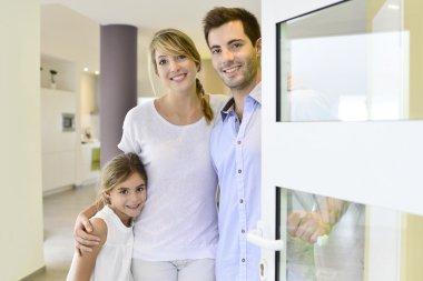 Family standing at front door