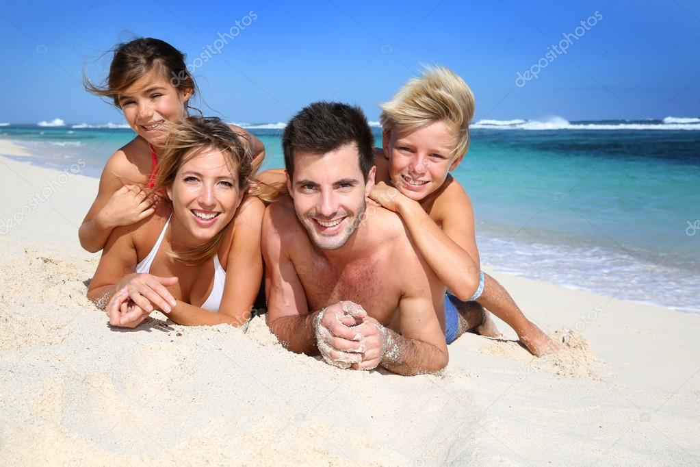 Family laying on the beach