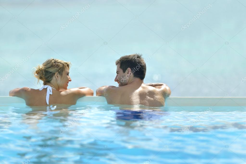 Couple swimming in infinity pool