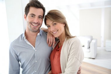 Couple standing in home