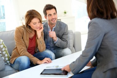 Couple meeting financial adviser