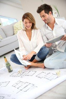 Couple celebrating house purchase