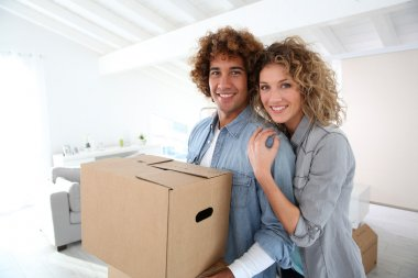 Couple moving in apartment