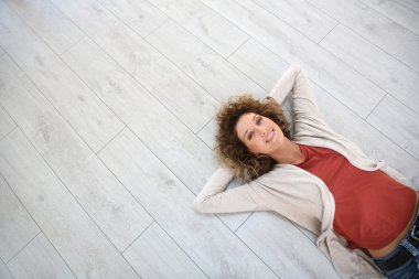 Woman on wooden flooring