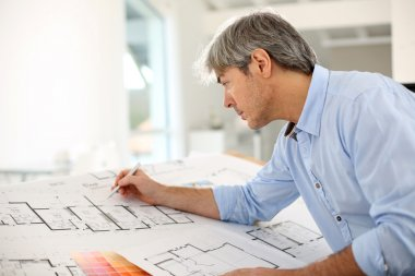 Architect designing house for client stock vector