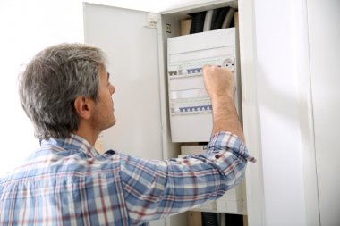 Technician checking on electric box