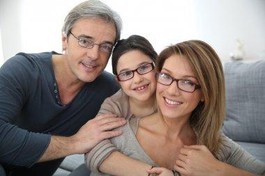 Portrait of family of 3 people wearing eyeglasses stock vector