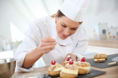 Cook spreading powdered sugar