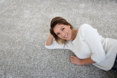 Woman relaxing on carpet