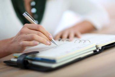 Hand writing on agenda