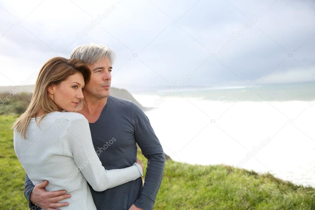 Couple on the ocean coastline