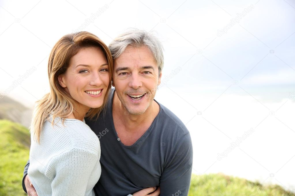 Couple on the ocean coastline