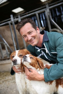 Breeder petting dogs