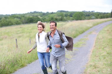Couple running in countryside