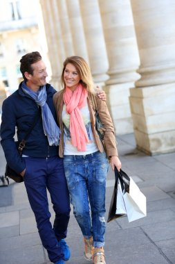 Embracing couple with shopping bags