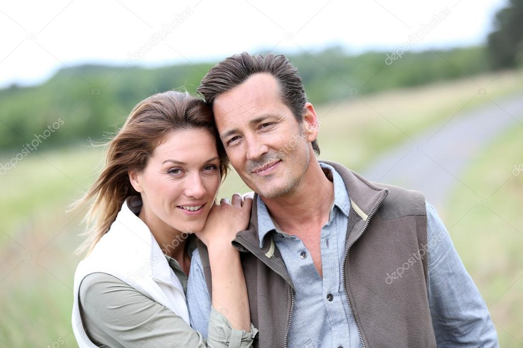 Cheerful couple in countryside