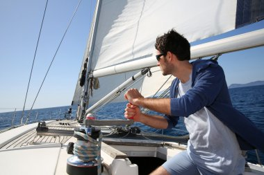 Man sailing with sails out