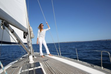 Woman on sailboat deck