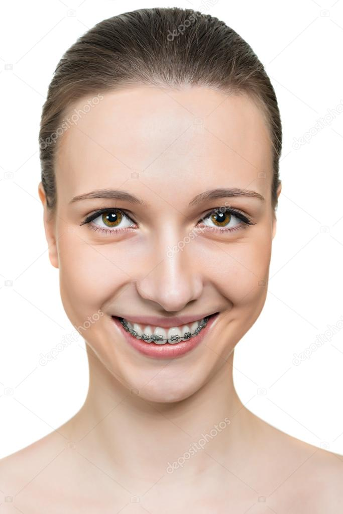 Portrait young woman with brackets on teeth
