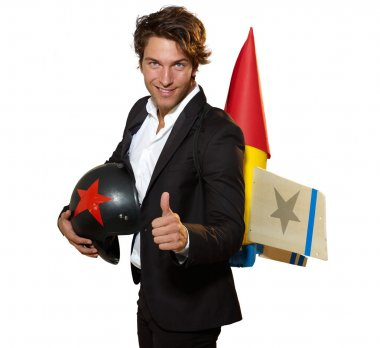 Young businessman with rocket on his back and thumb up