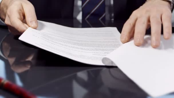 Businessman watch through the contract and sign it.