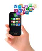 Ruka držící mobilní telefon s ikonami. vektor