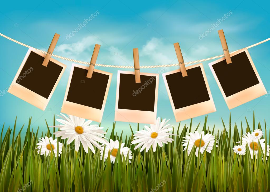 Photos hanging on a rope in front of a nature summer background.