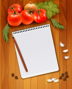 Fresh vegetables and spices on a wooden background and notebook