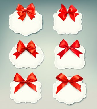 Set of beautiful retro labels with red gift bows with ribbons. V