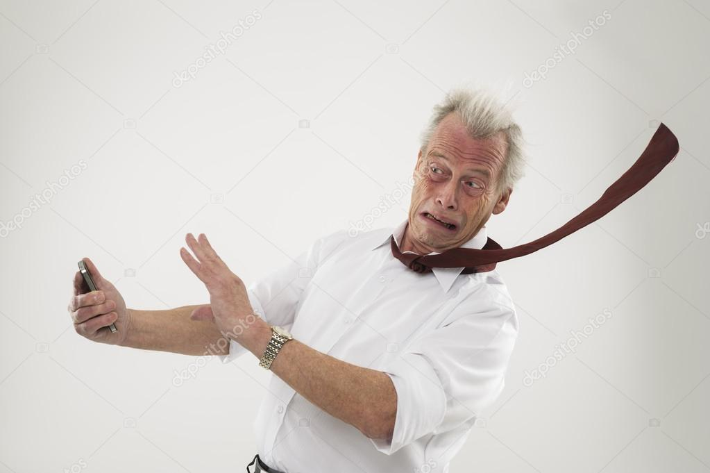 Businessman being battered by strong winds