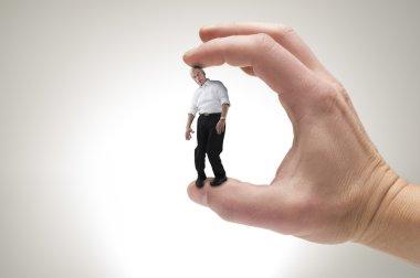 Concept picture of studio man between fingers