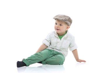 Handsome little boy in a cap