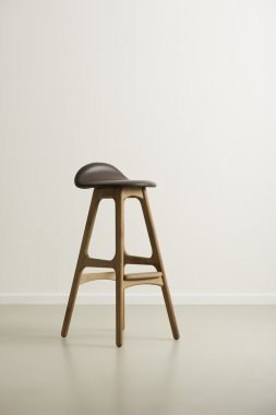 Moderrn wooden bar stool with a leather seat