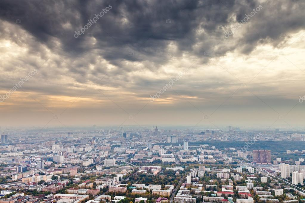 Dark yellow gray clouds under autumn Moscow